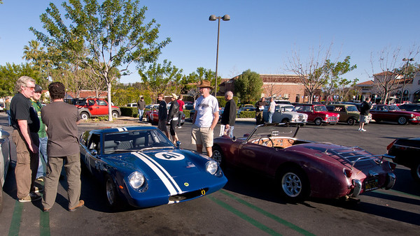Members of the other vintage motoring group check out each others cars.